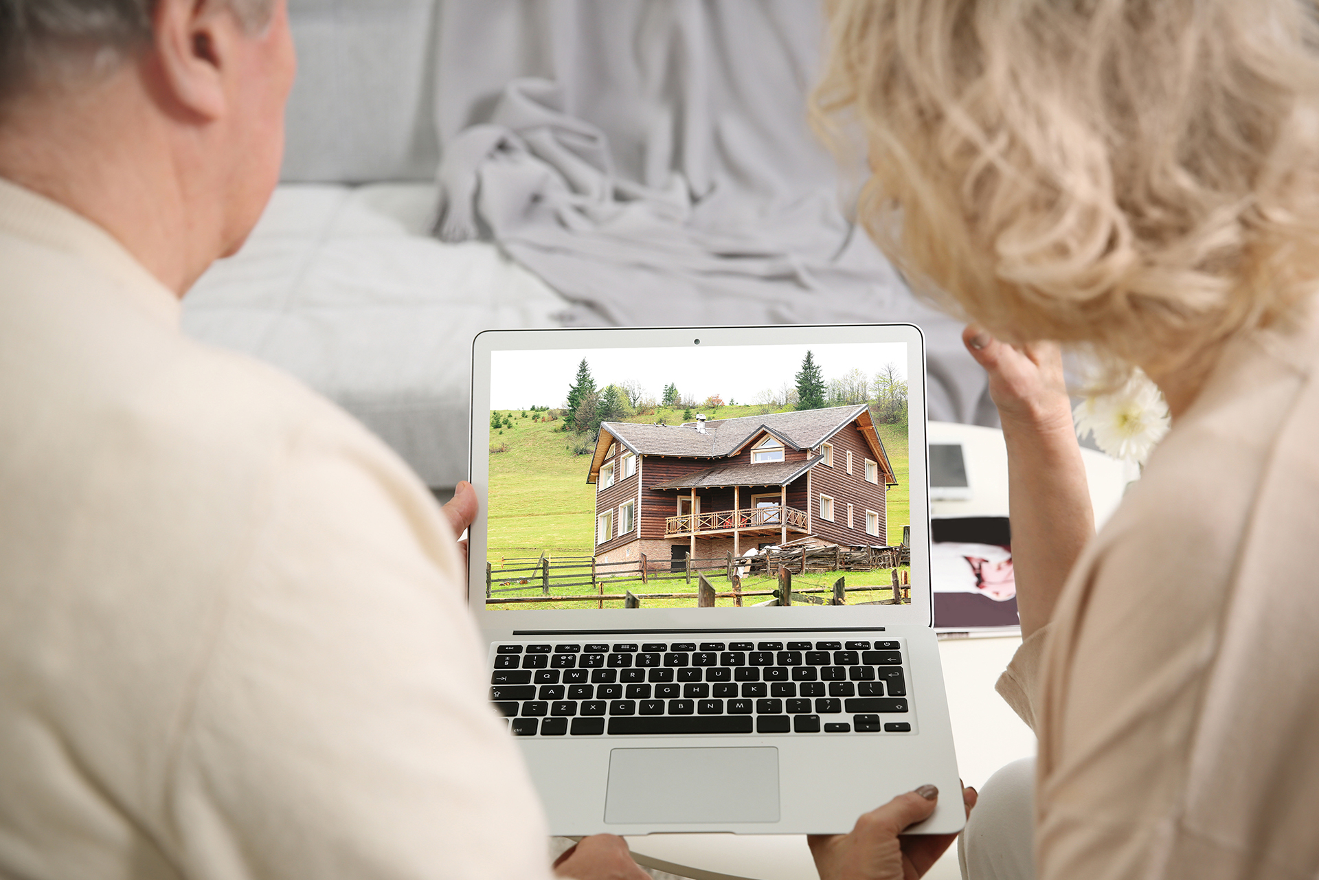 Online shopping concept. Senior couple looking for house on real estate market website